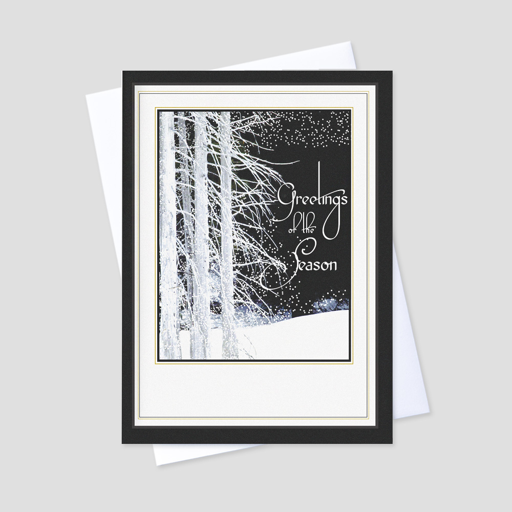 Professional Holiday greeting card featuring a black and white winter forest with a white space at the bottom of the potrait card to allow for company personalization