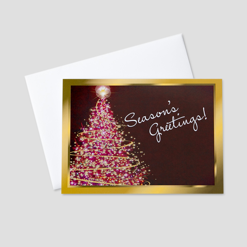 Festive Holiday greeting card with a golden colored border, burgundy background, and season's greetings message next to a beautifully colored Christmas tree