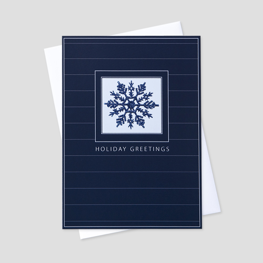 Client Holiday greeting card with an image of a navy snowflake inside a blue border and horizontal white stripe design