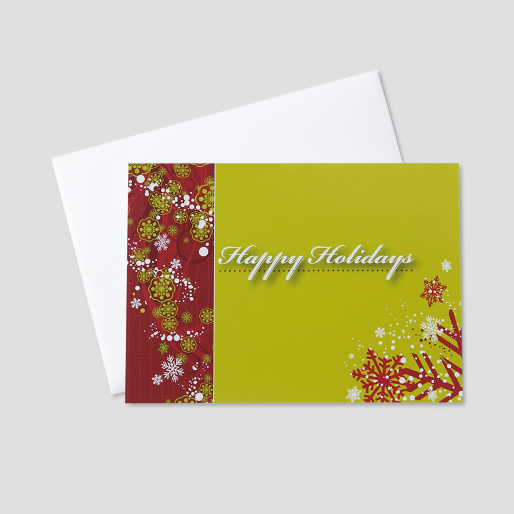 Holiday greeting card with a happy holidays message decorated with snow and snowflakes in a lime green and red color scheme