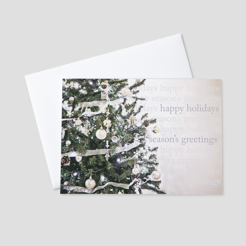 Client Holiday greeting card with an image of a decorated christmas tree and multiple holiday messages in shades of blue