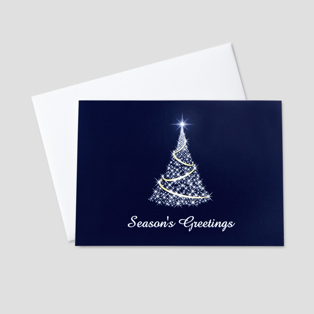 Professional Holiday greeting card with an image of a bright, twinkling christmas tree against a navy blue background