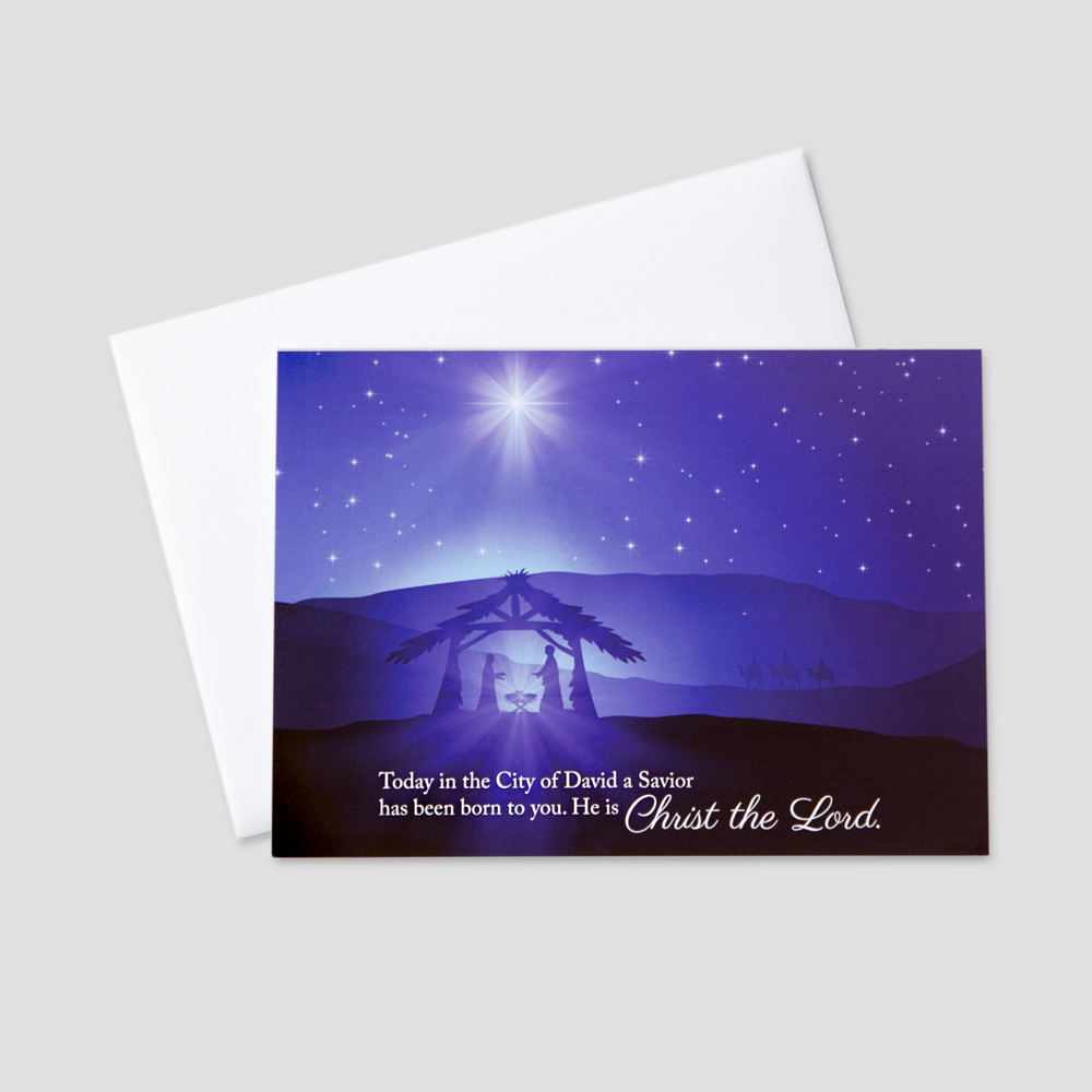 Business Christmas greeting card featuring a nativity scene with a biblical Christmas message