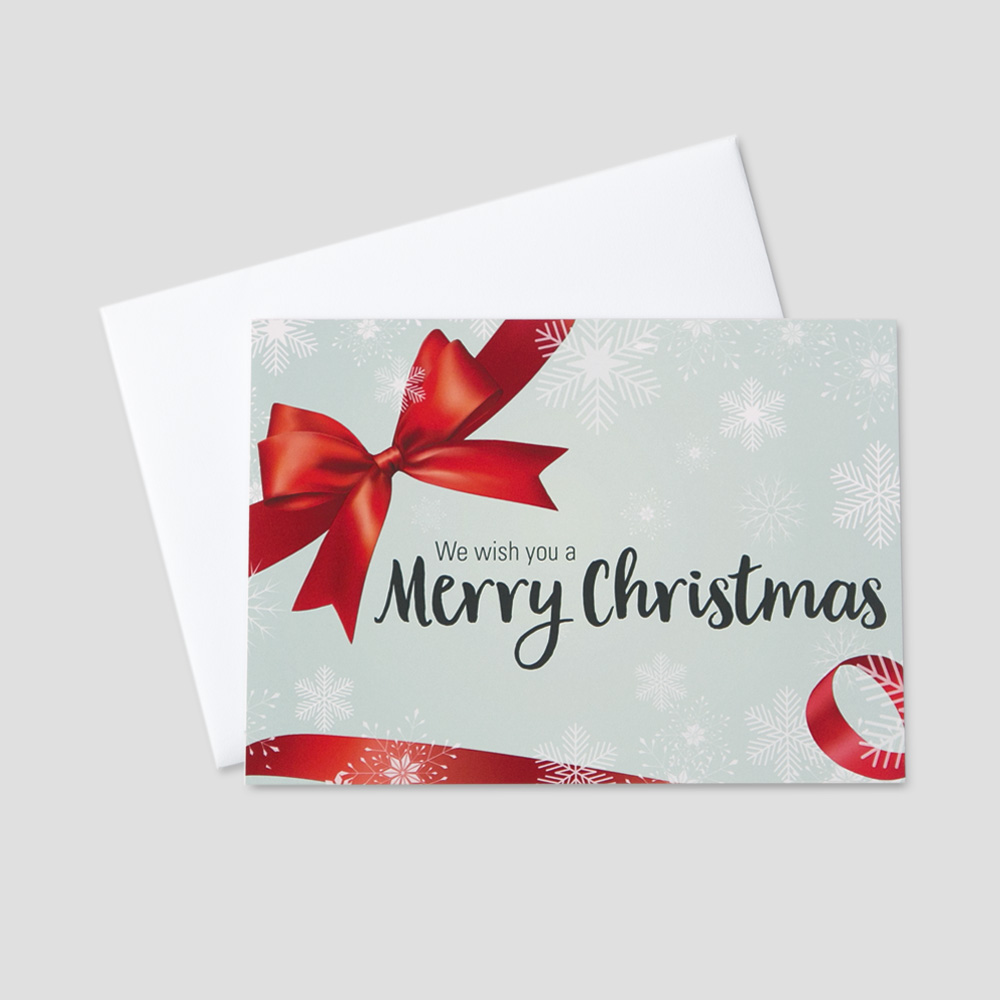 Corporate Christmas greeting card with a Christmas message surrounded by falling snowflakes and red bow