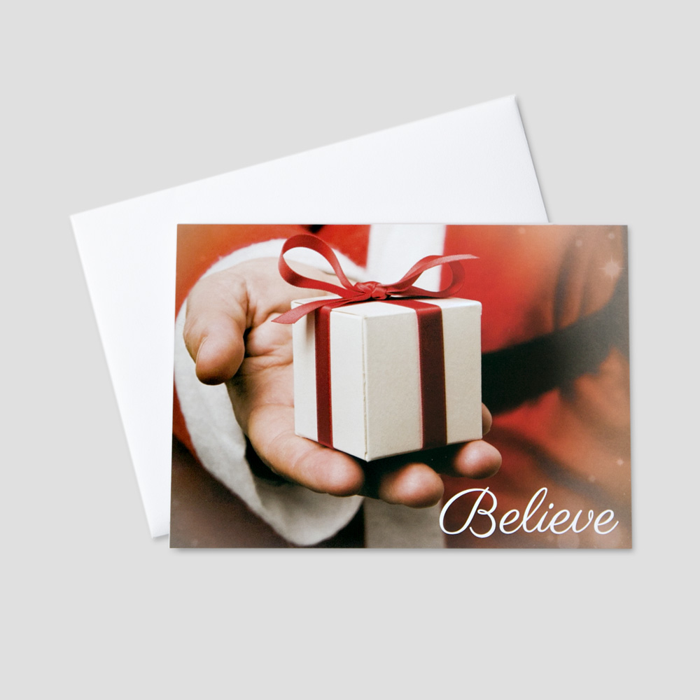 Festive Christmas greeting card with Santa Claus holding a present with a special Christmas message