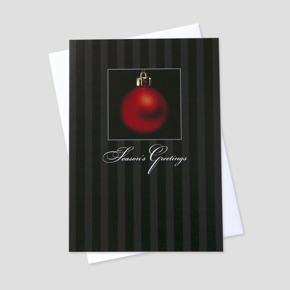 Professional Holiday greeting card with a black and gray vertical striped background and a red ornament as the center of focus