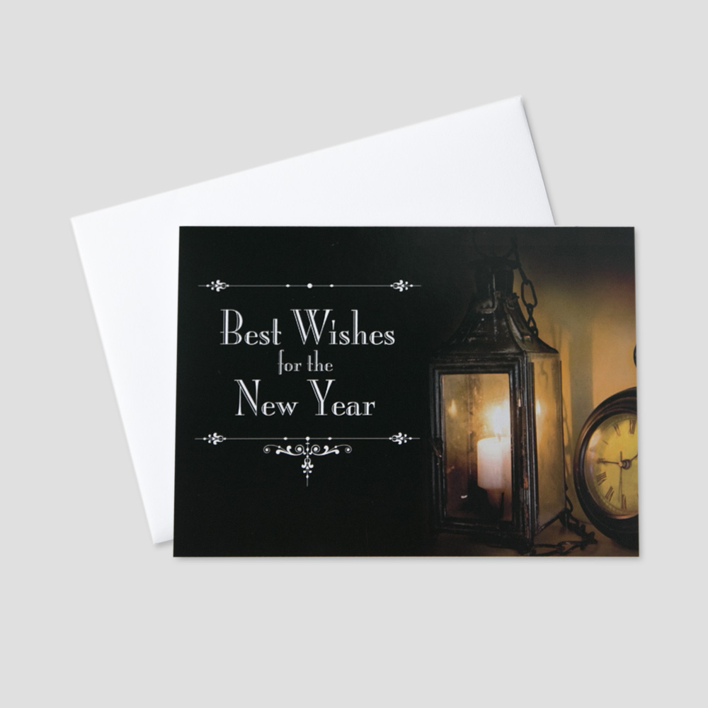 Business New Year greeting card with an old candle and pocket watch on a black background