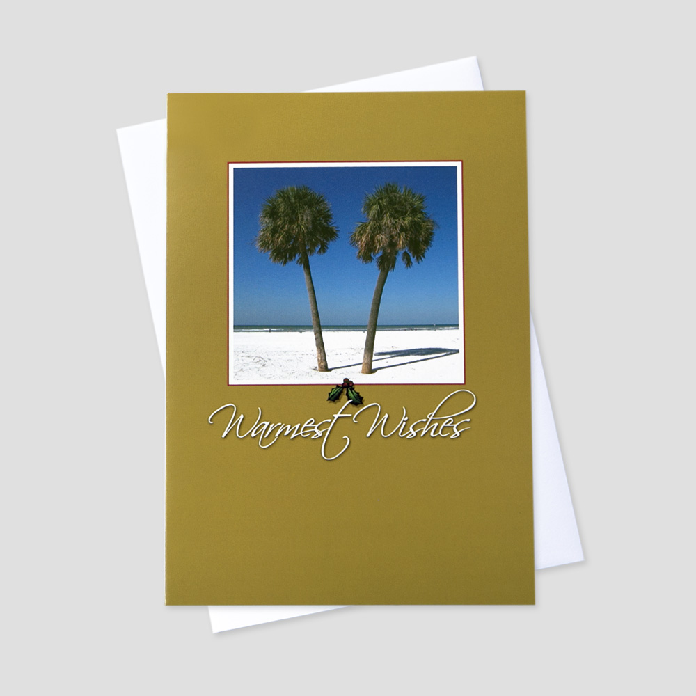 Business Holiday greeting card featuring warmest wishes below a palm tree and beach image