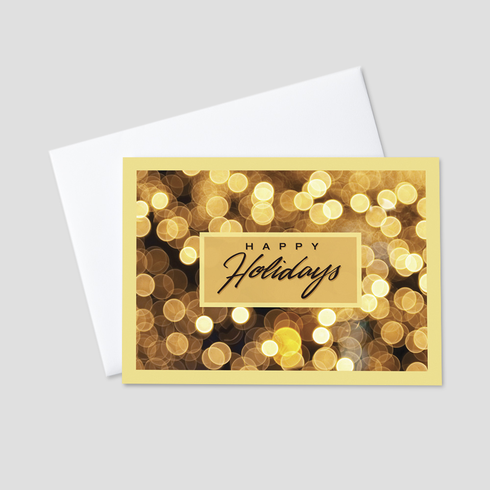 Business Holiday greeting card featuring a happy holidays message surrounded by golden colored holiday lights