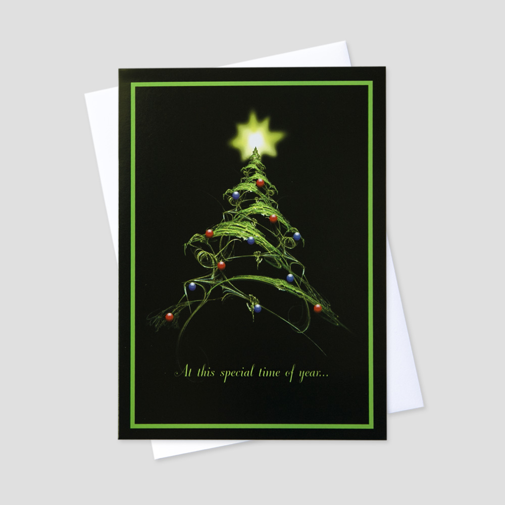Professional Holiday greeting card with a graphic design decorated green fir tree against a black background and matching green border