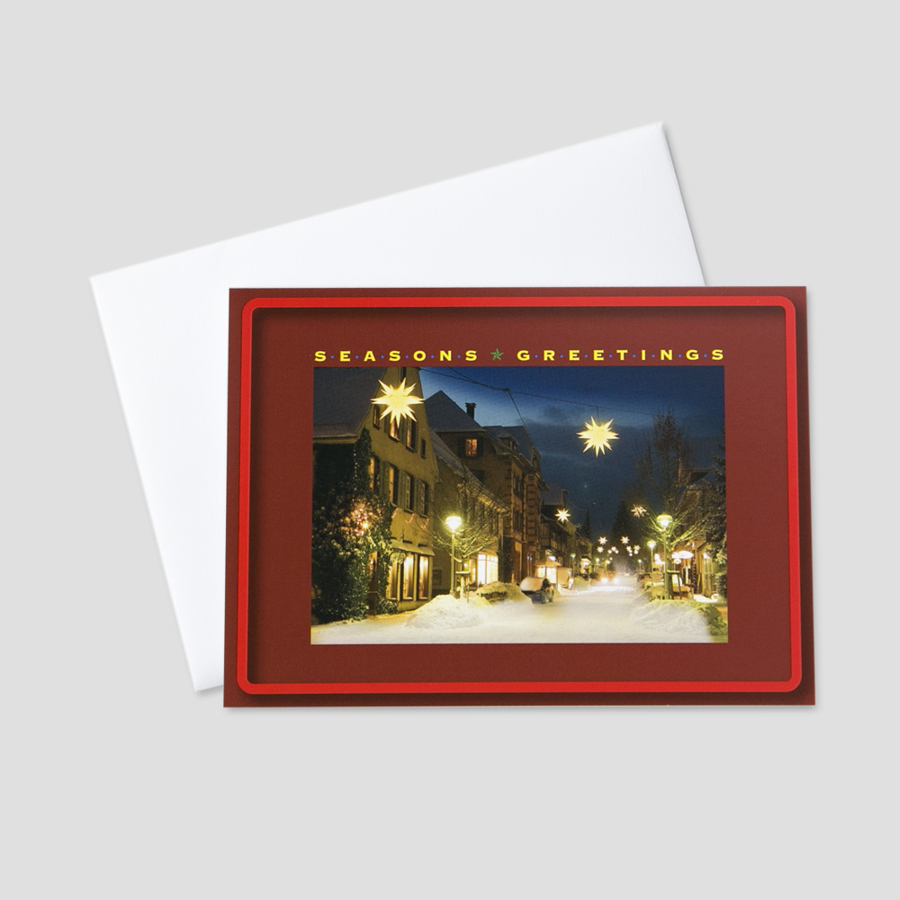 Customer Holiday greeting card with an image of a small town decorated for the holiday season