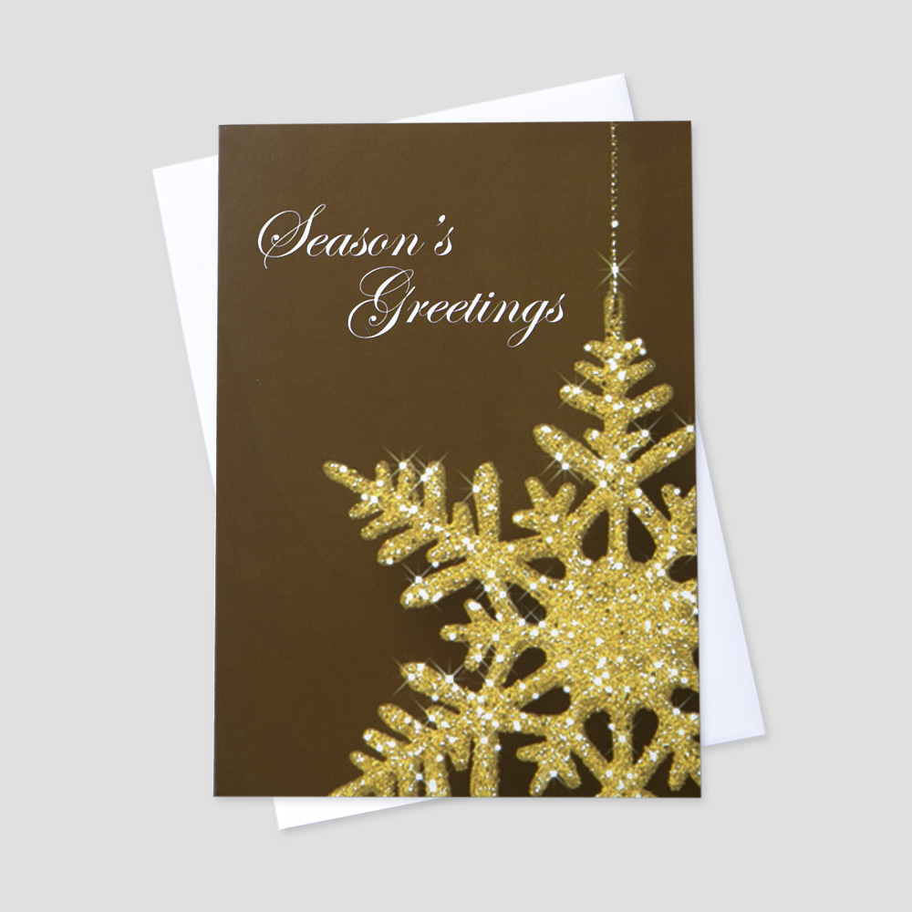 Professional Holiday greeting card with an image of a gold snowflake on a subtle brown background