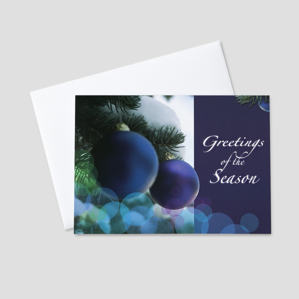 Company Holiday greeting card with an image of a purple holiday ornaments on snowy branches
