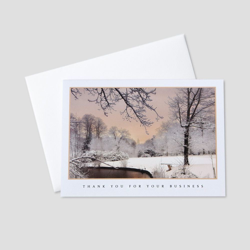 Professional Holiday greeting card with an image of a pond in a snowy winter scene