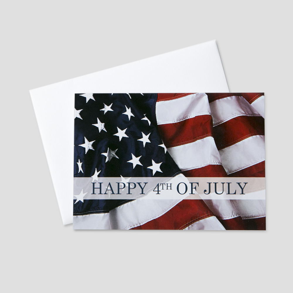 Corporate July Fourth greeting card with an image of the American Flag waving in the wind