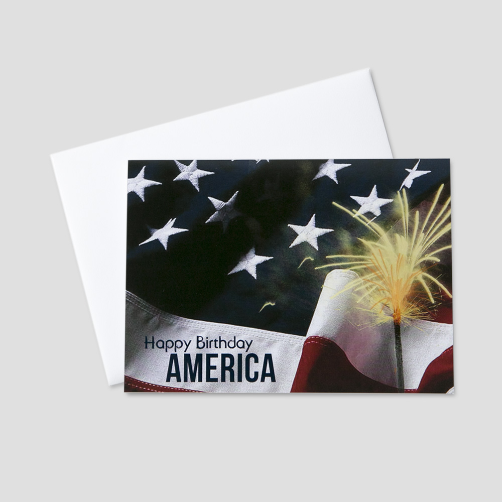 Customer July Fourth greeting card with an image of the American Flag and a sparkler with a Happy Birthday July 4th message