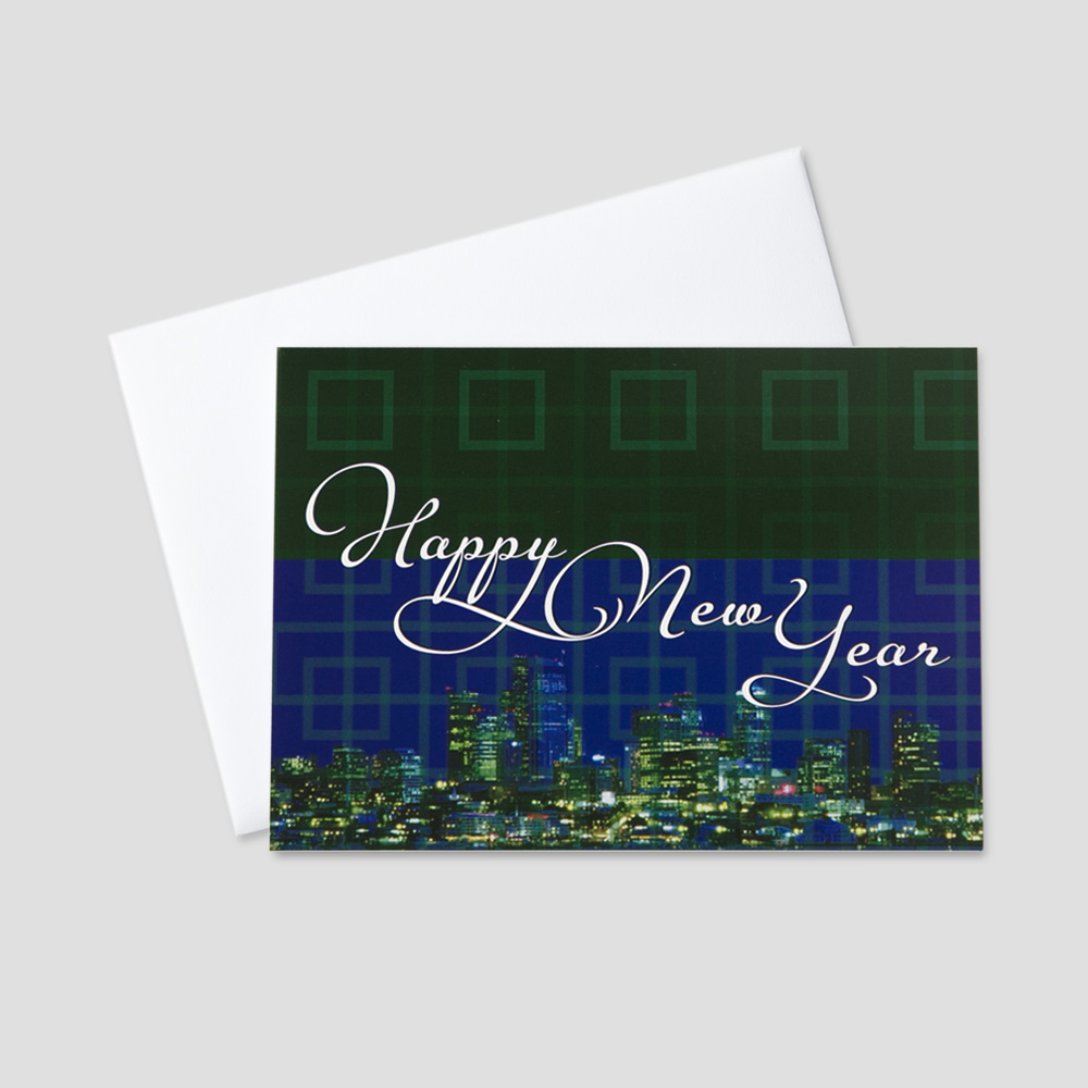 professional new year greeting card with an image of a city scape at night and happy
