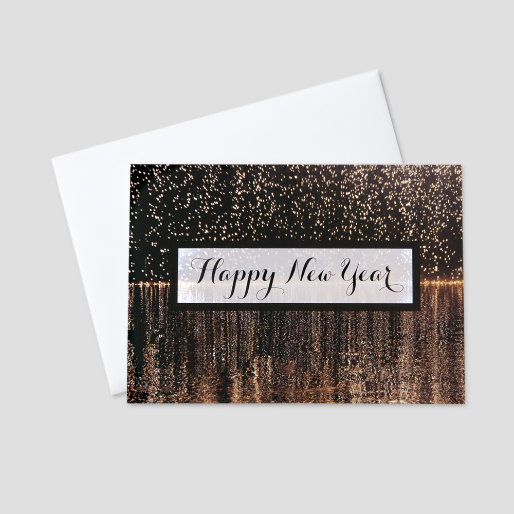 Professional New Year greeting card with a happy new year message and golden falling fireworks on a black background
