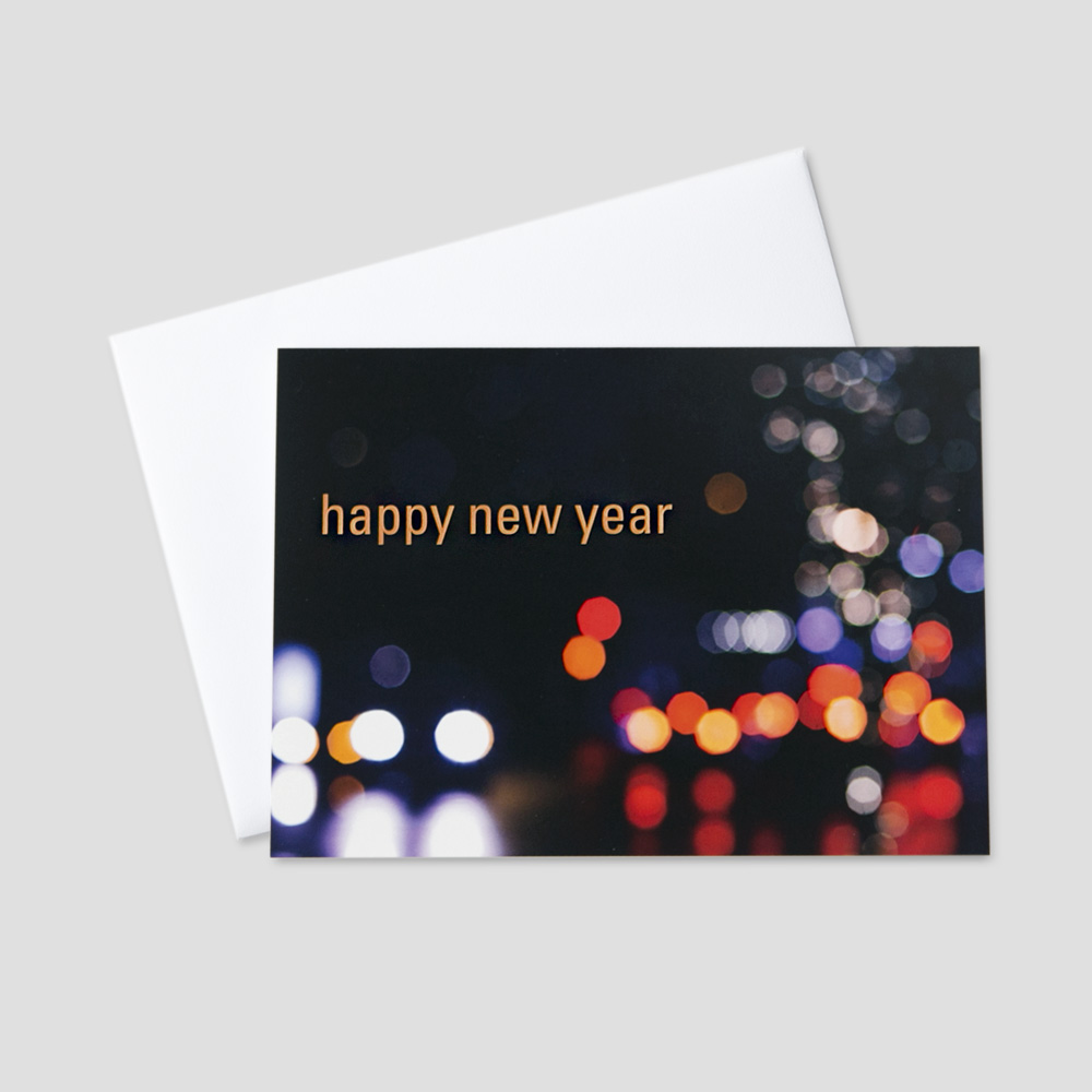 business new year greeting card with happy new year on a night city scene and dark