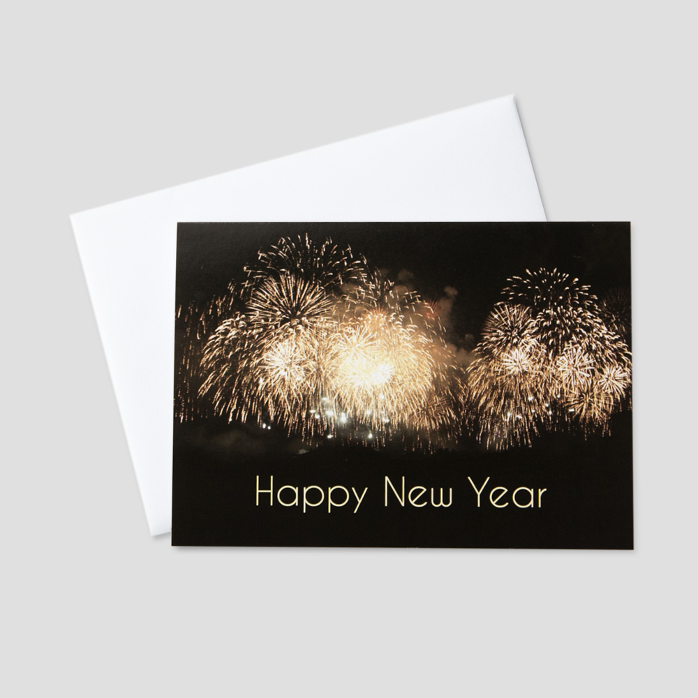 Professional New Year greeting card with large golden fireworks among a New Year message on a black background