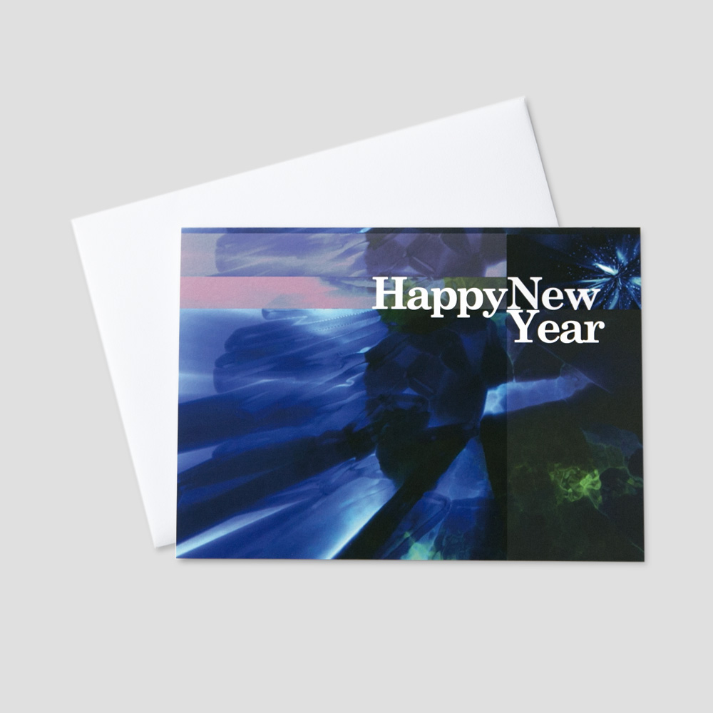 Festive New Year greeting card featuring a burst of multiple colors and a new year message
