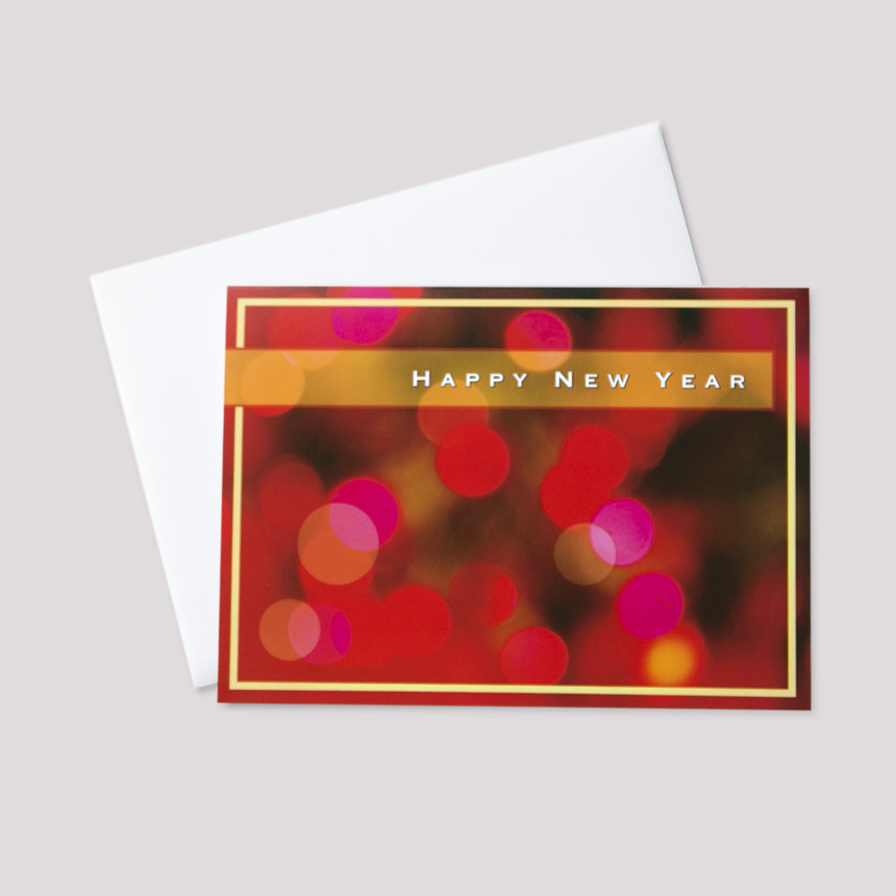 Customer New Year greeting card with a happy new year message on a bright red and pink lights background bordered in orange
