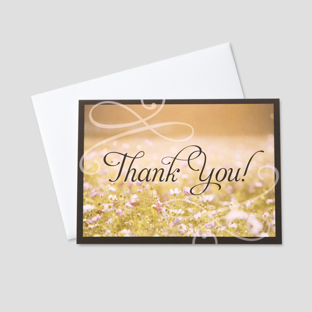 Client Thank You greeting card featuring a field of flowers and a thank you message