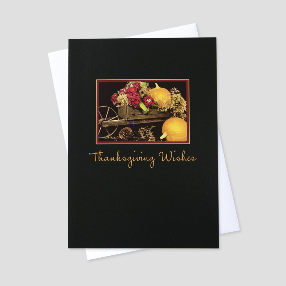 Business Thanksgiving greeting card featuring an old wheel barrow filled with pumpkins and flowers
