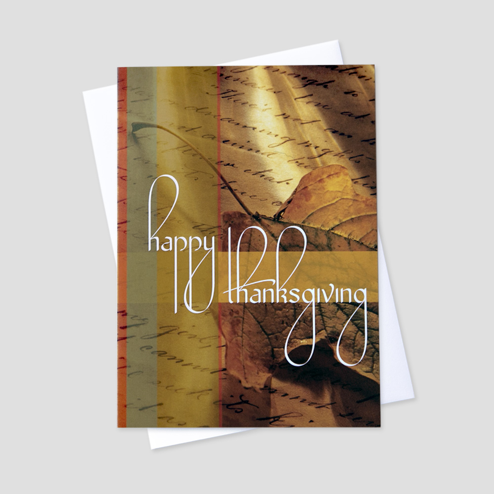 Business Thanksgiving greeting card featuring a background of parchment paper with scroll writing and a fall leaf behind a Thanksgiving message