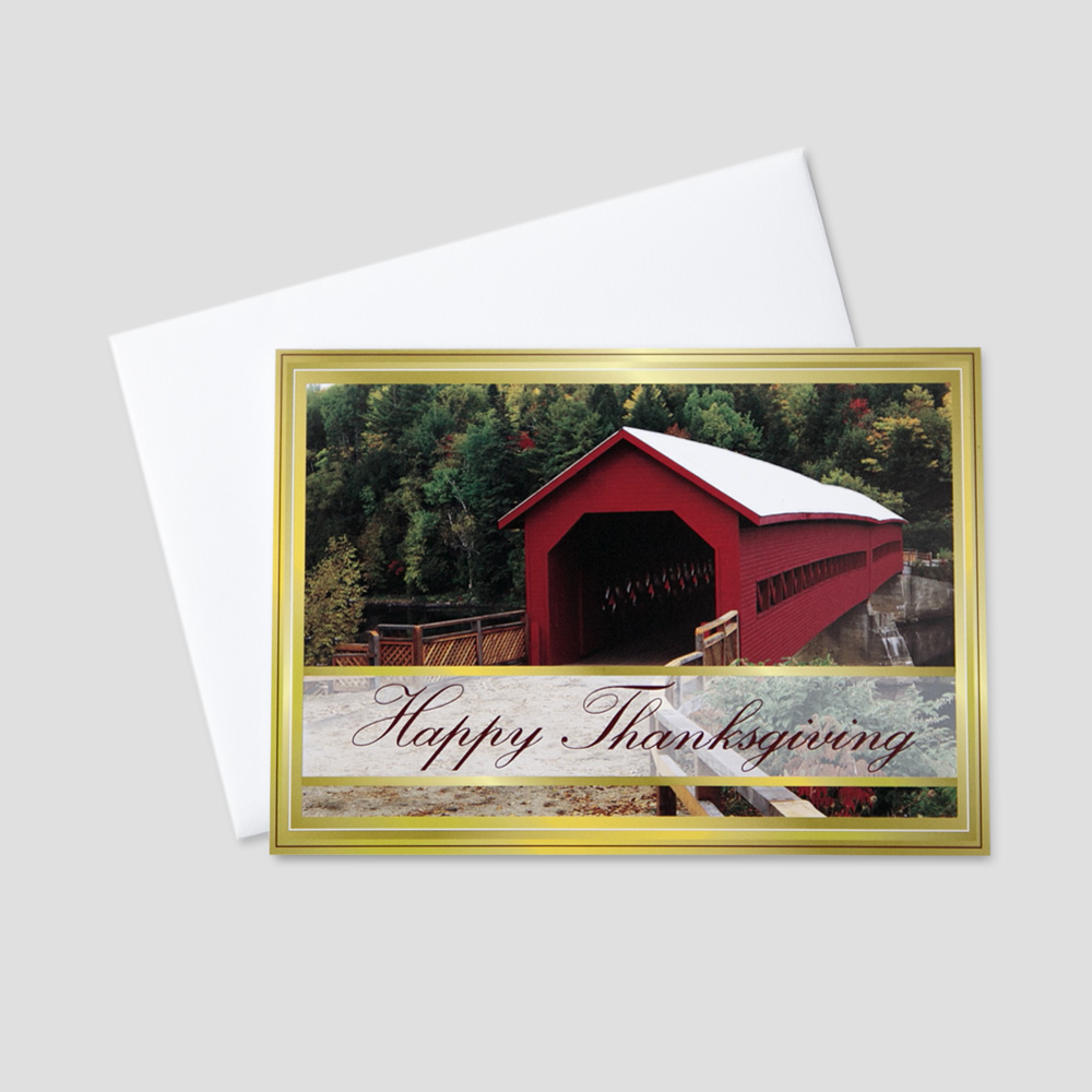 Business Thanksgiving greeting card featuring an old red covered bridge and bordered with a golden color