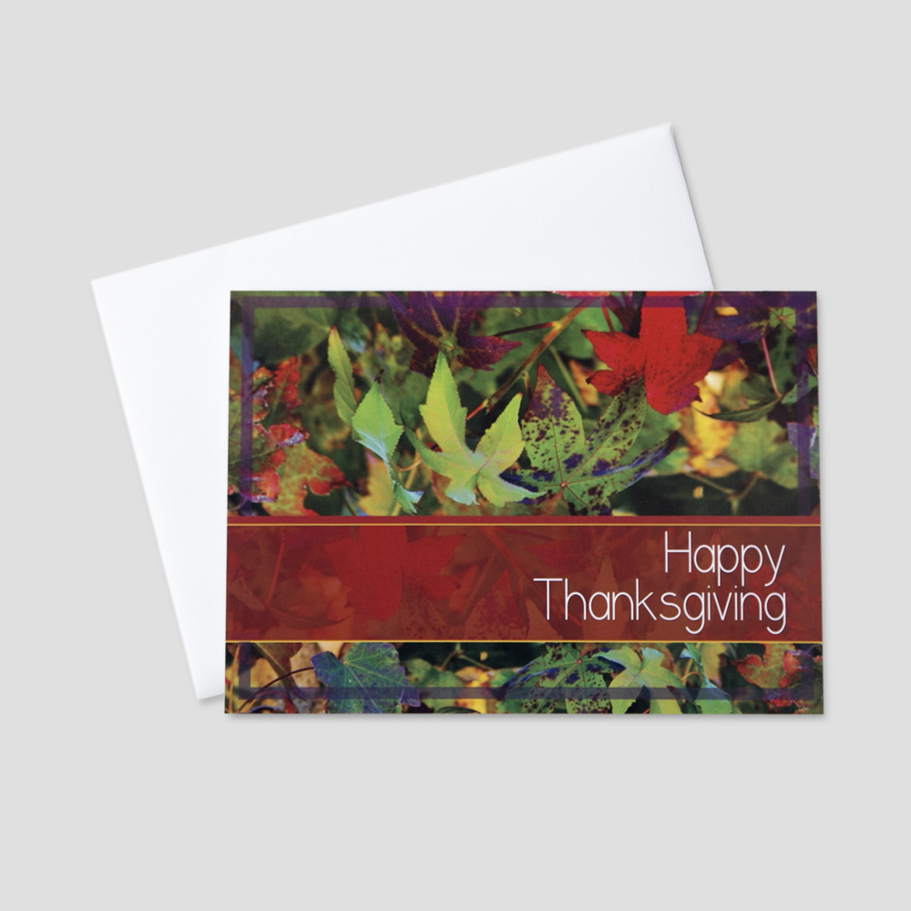 Employee Thanksgiving greeting card featuring colorful leaves and a Thanksgiving message blocked off in red