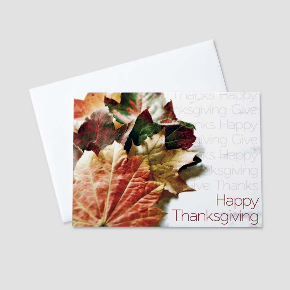 Professional Thanksgiving greeting card featuring autumn leaves with repeating thanksgiving messages on a white background