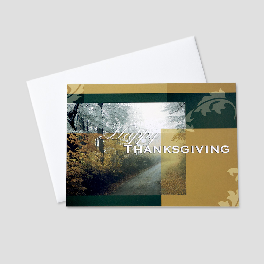 Business Thanksgiving greeting card featuring a country road with colorful autumn leaves