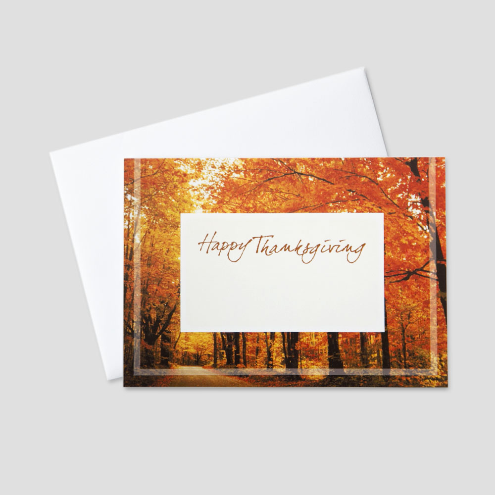 Professional Thanksgiving greeting card featuring a fall colored forest and a white space in the middle of the card which allows for company personalization