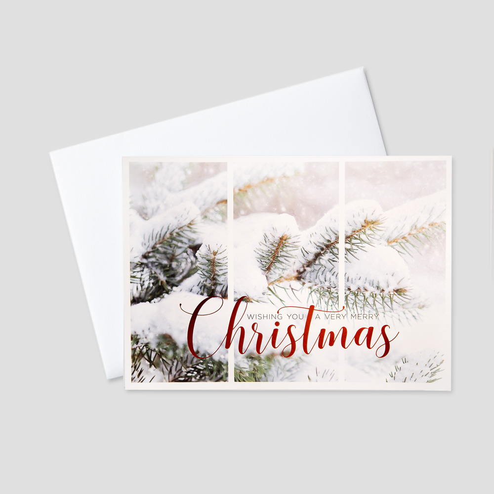 Corporate Christmas greeting card with snow-covered pine trees and a Christmas message in red foil print