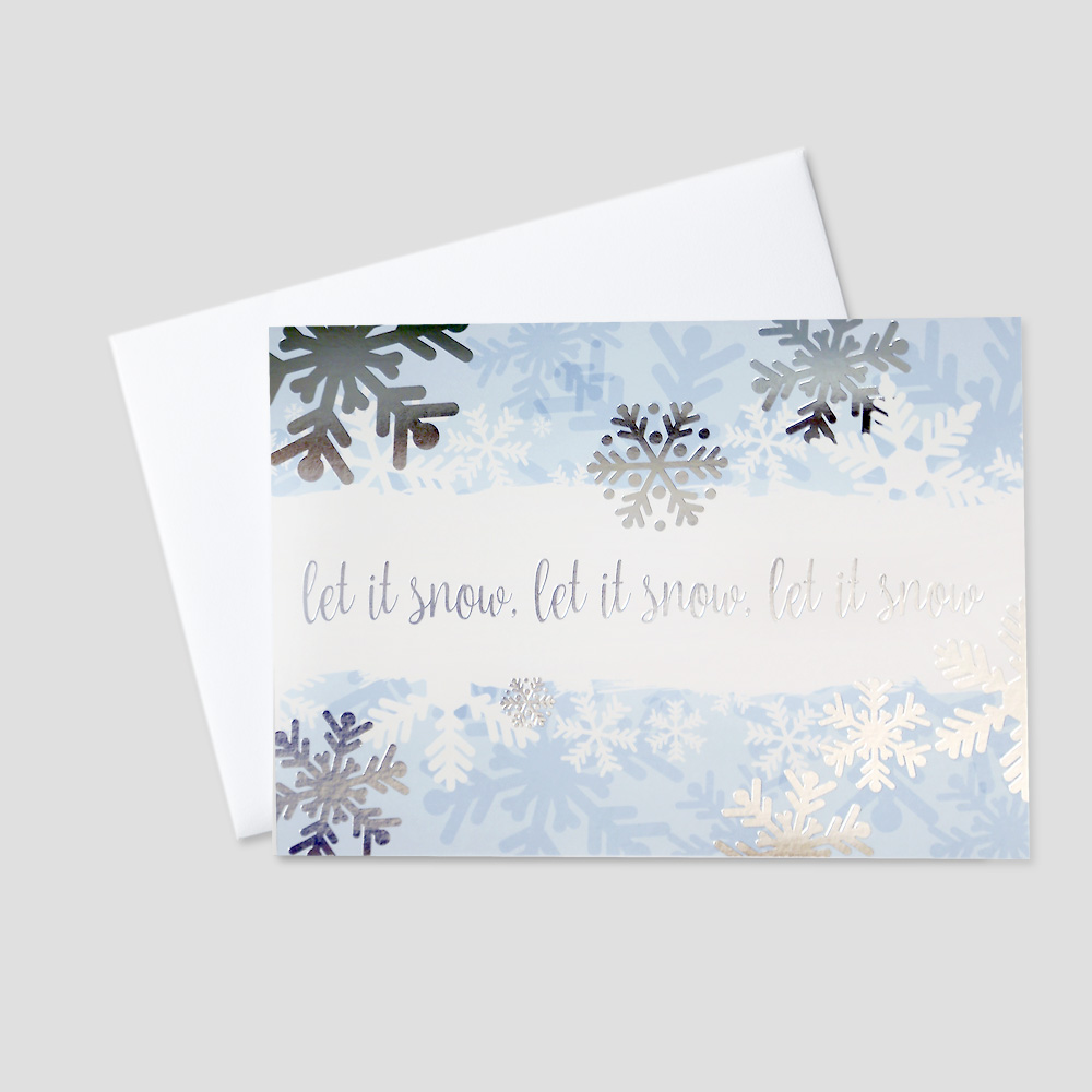 Business Holiday greeting card with falling snowflakes of different designs and sizes with silver foil print and a Let It Snow greeting in silver foil print