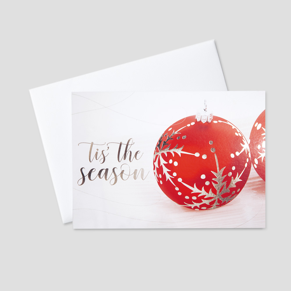 Business Season's Greetings greeting card featuring two red ornaments contrasted with silver foil designs and a Tis The Season message in silver foil print