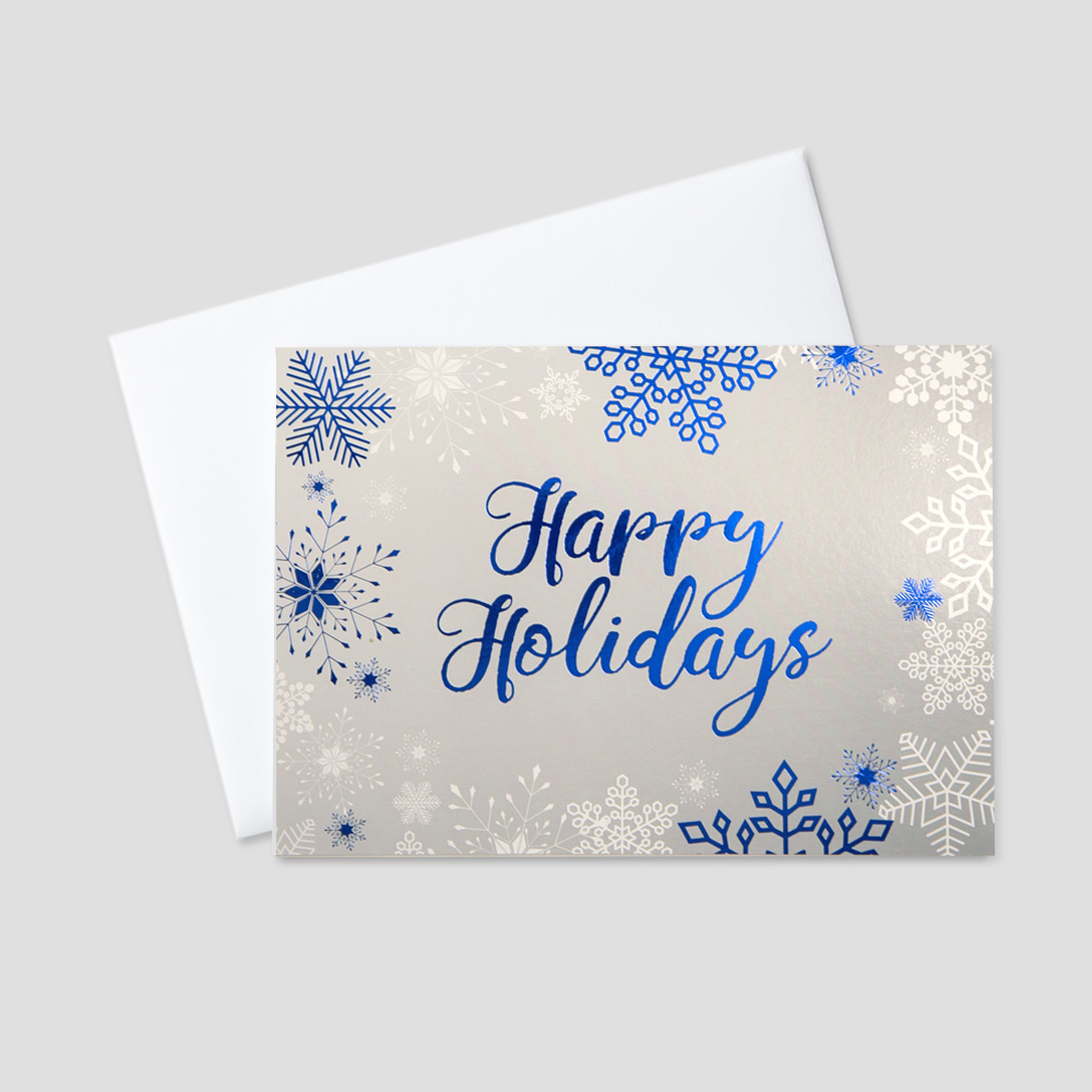 Client Holiday greeting card with a blue foil printed Happy Holidays message surrounded by blue foil printed snowflakes and a contrasting gray background
