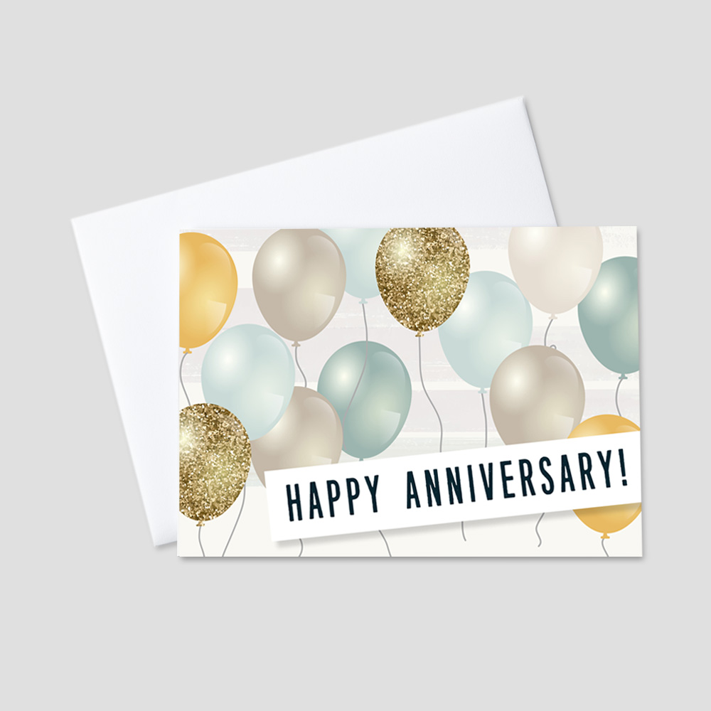 Company Anniversary Greeting Card featuring shades of green, gold, tan, and yellow balloons on a brush stroke striped background with a bold block font Happy Anniversary message.