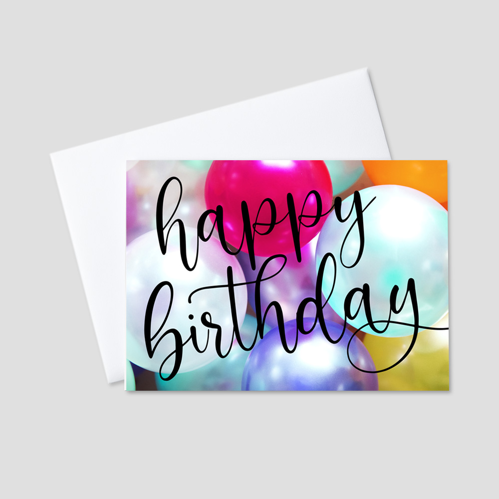 Corporate Birthday Greeting Card featuring a script Happy Birthday message written in black in front of a sea of colorful floating balloons