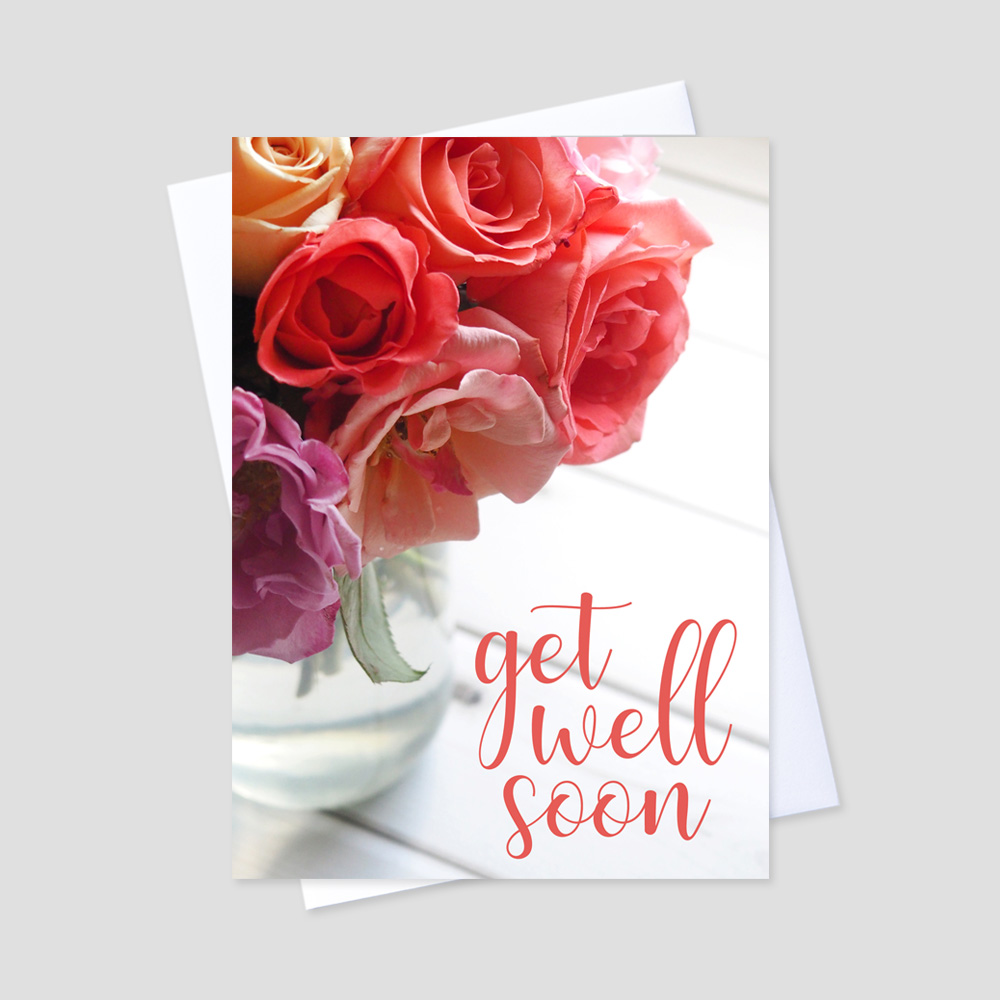 Business Get Well Greeting Card featuring a script get well soon message on a white background next to a bouquet of pink flowers in a glass vase