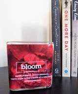 Bloom fundraiser candle in collaboration with Tall Poppy Writers