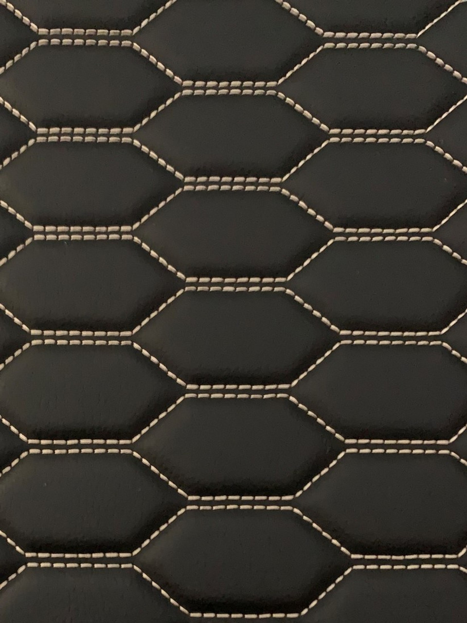 Quilted automotive grade black vinyl with white-gold stitching