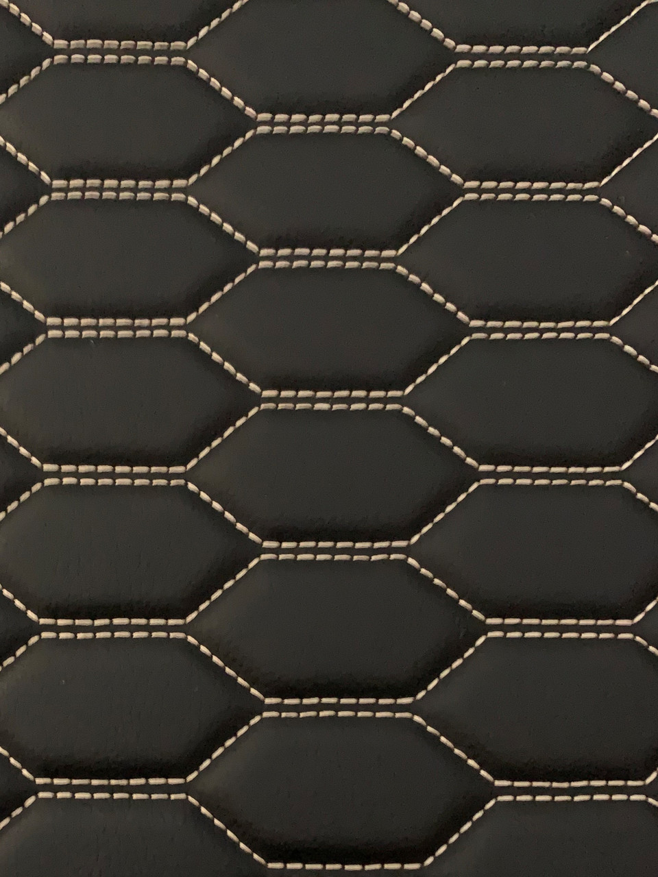 Real quilted automotive grade black vinyl with white-gold stitching