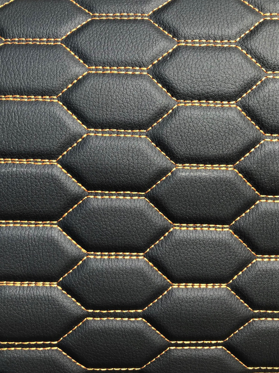 Quilted automotive grade black vinyl with gold-bronze stitching