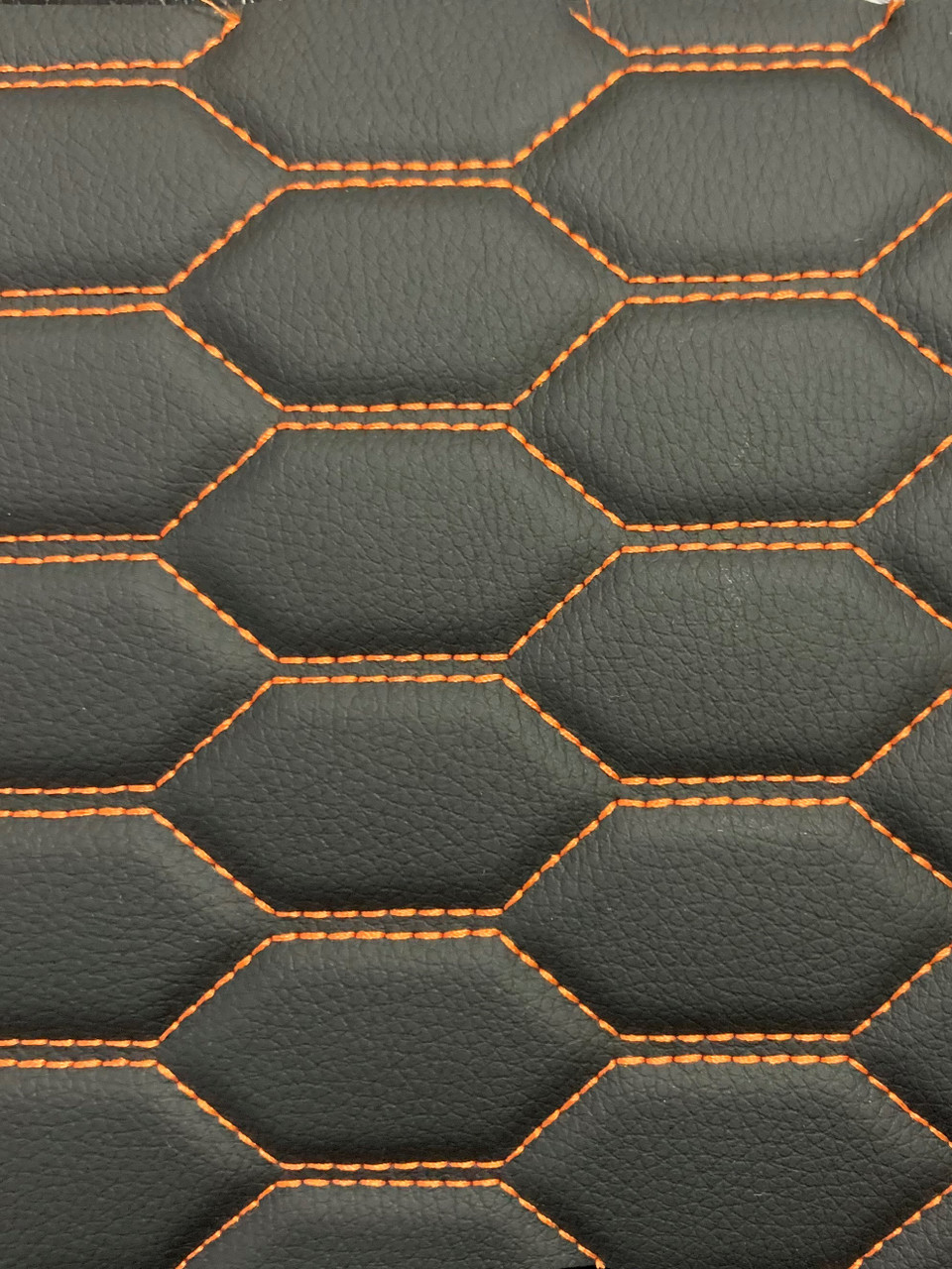 Real quilted automotive grade black vinyl with orange stitching
