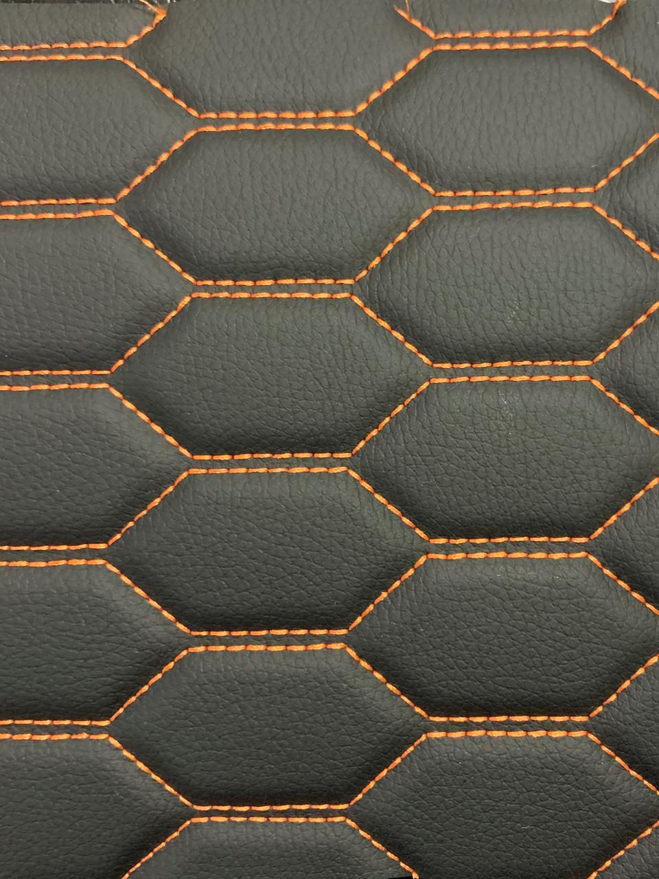 Quilted automotive grade black vinyl with orange stitching