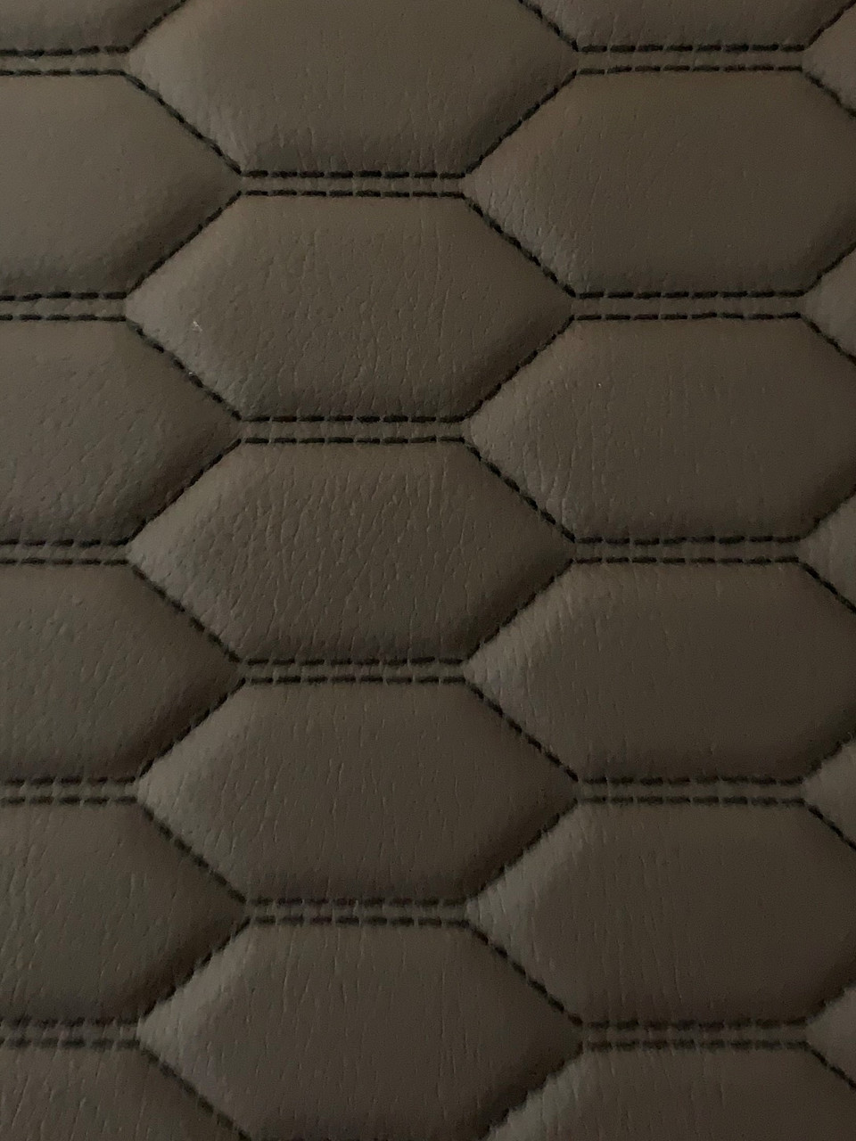 Real quilted automotive grade brown vinyl with black stitching