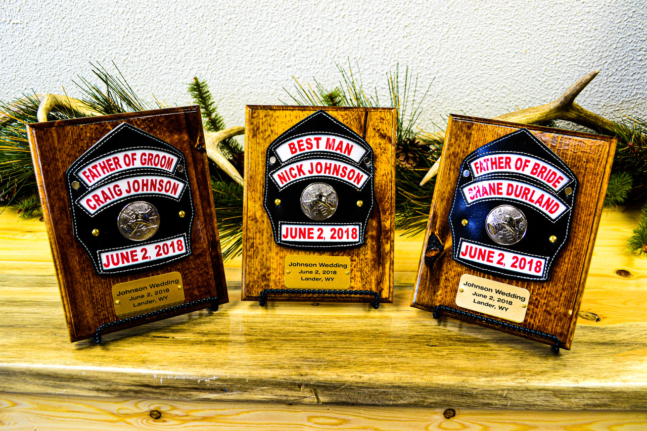 Custom Firefighter groomsman gifts mounted on burned pine.