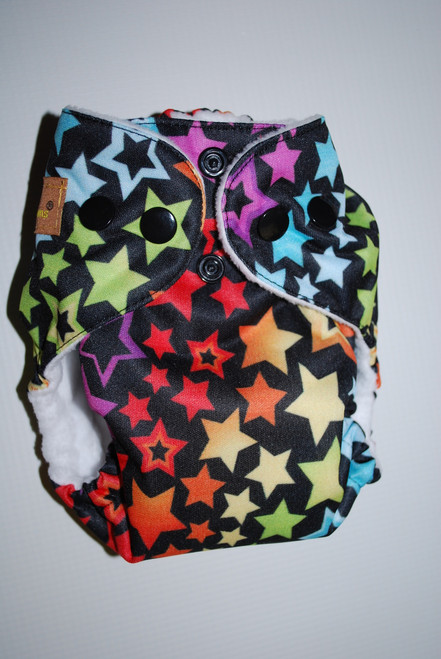 Stars on black newborn AIO diaper. Please note that lining color may vary from white.